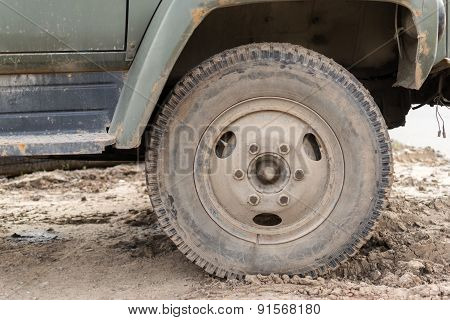 Muddy Dust Covered Vehicle Wheel