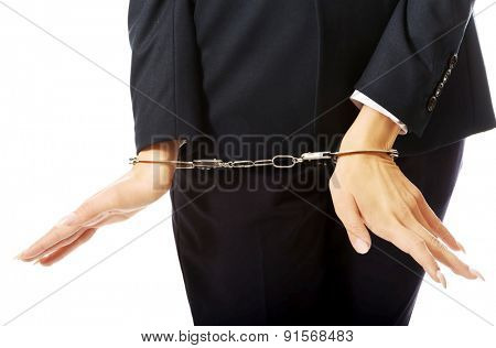 Close up on businesswoman with handcuffs.