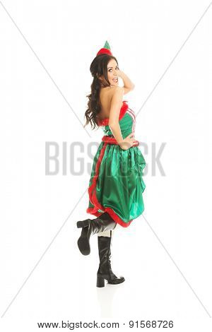 Back view of woman wearing elf clothes bending knee.