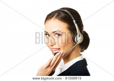 Portrait of happy phone operator in headset.