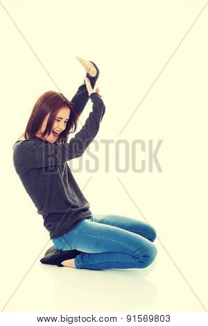 Young woman trying to protect herself