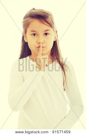 Beautiful little girl asking for silence