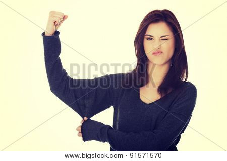 Young woman showing her strength.