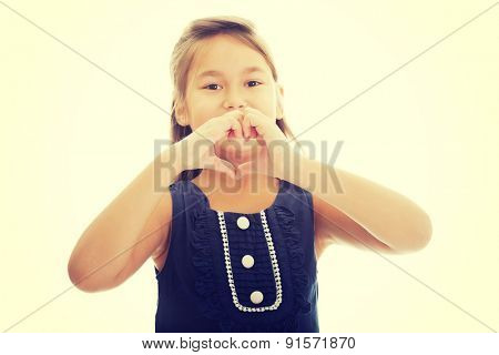 Cute little girl shows hearts on hands