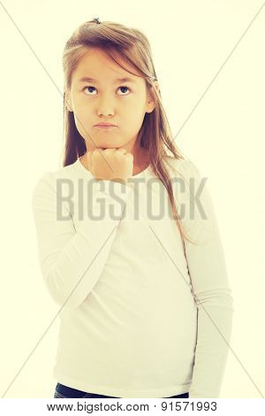 Little girl thinking about something interesting