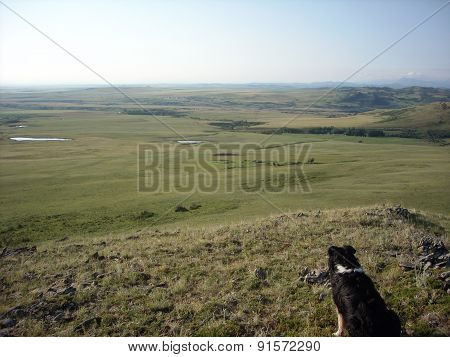 long view over foothills and prairie
