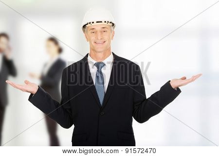 Mature man with hard holding copyspace in hands.