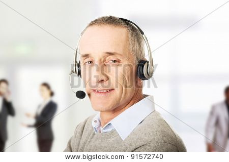 Call center mature man wearing a headset.