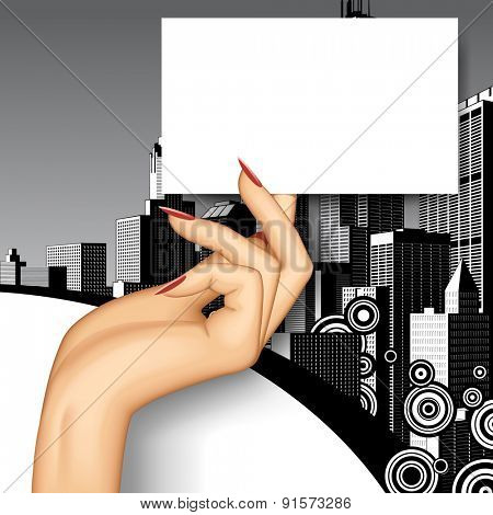 Female hand holding business card on retro city background