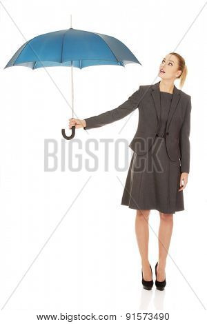 Attractive businesswoman holding an umbrella.