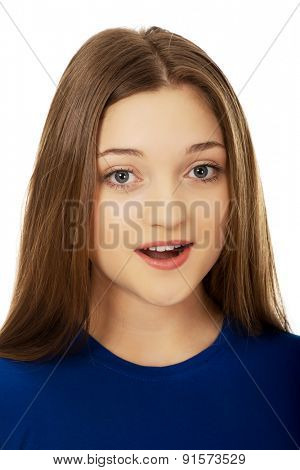 Beautiful teenage woman with shock expression.