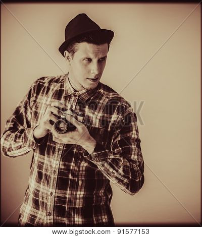 Young Man With Old Photo Camera