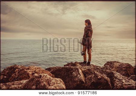 Girl Standing On Coast. Vintage Color