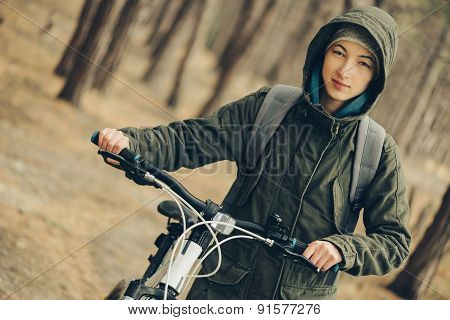 Hiker Girl With Bicycle