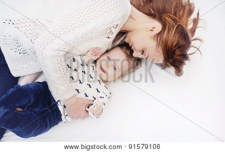 Happy Caring Mother With Her Cute Baby Boy