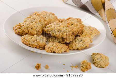 Freshly Baked Oatmeal Cookies On A White Plate.