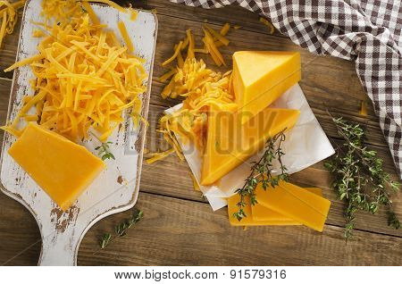 Cheese On  A White Wooden Cutting Board.