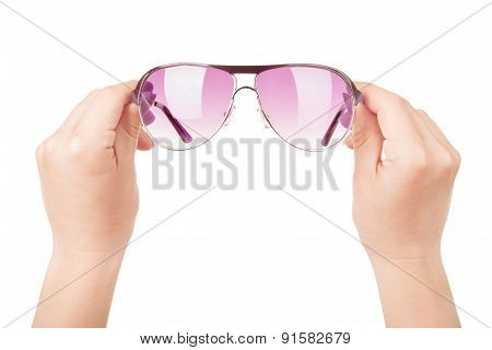 Female Hand Holding Glasses. Isolated On White