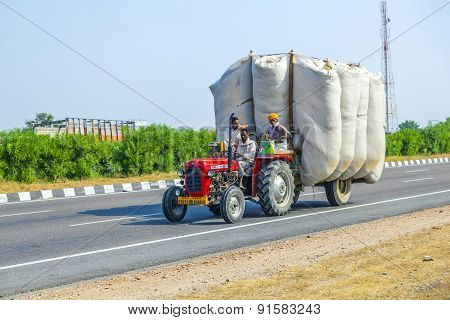 Straw Transport With Tractor On Country Road