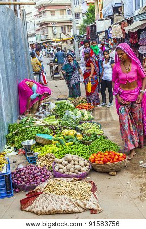 Vendors Sell Goods In A Vegetable Street Market