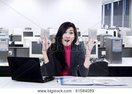 Cheerful Worker Looks Surprised