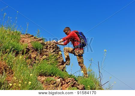 Man Climbs On A Cliff