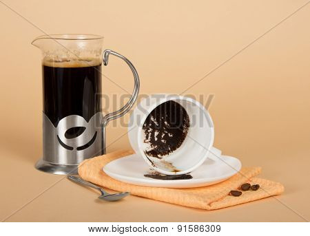 Coffee pot and overturned cup