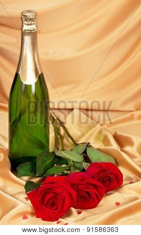 Red roses and bottle of champagne