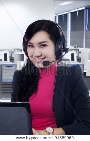 Young Call Center Operator Smiling At Camera