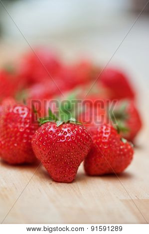 Fresh strawberries  at wooden background