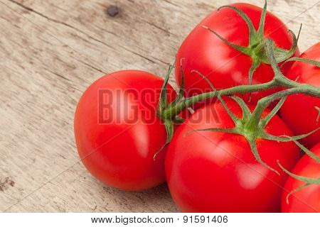 Bunch Of Red Tomatoes On Rustic Wooden Table - Studio Shot
