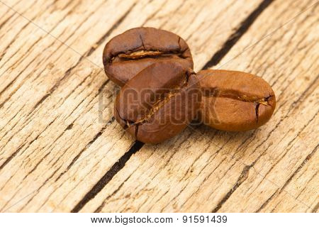 Coffee Beans On Old Table - Close Up Shot