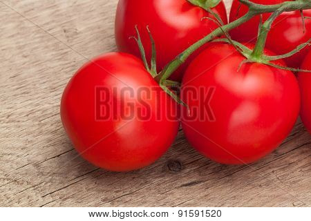 Bunch Of Red Tomatoes On Rustic Wooden Table - Close Up Shot