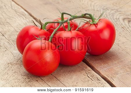 Bunch Of Red Tomatoes On Wooden Table - Studio Shot