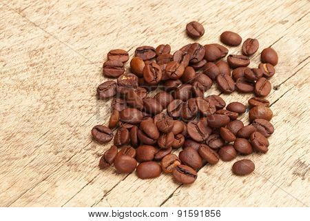 Coffee Beans Over Old Wooden Table