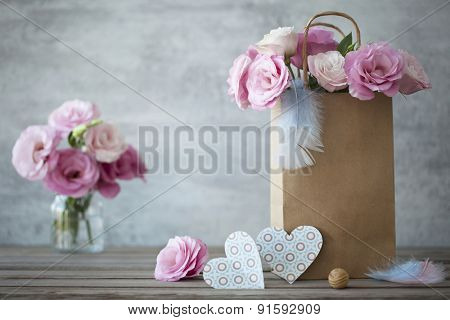 Still life romantic background with pink roses and blue hearts