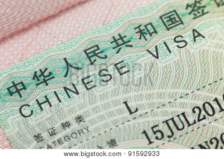 Chinese visa in a passport  page  -  enjoy travel background
