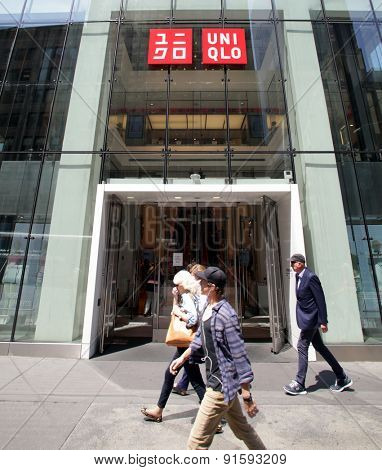 NEW YORK CITY - FRIDAY, MAY 8, 2015: Pedestrians walk past an Uniqlo clothing store in Manhattan. Uniqlo Co., Ltd. is a Japanese retailer and subsidiary of Fast Retailing Co., Ltd