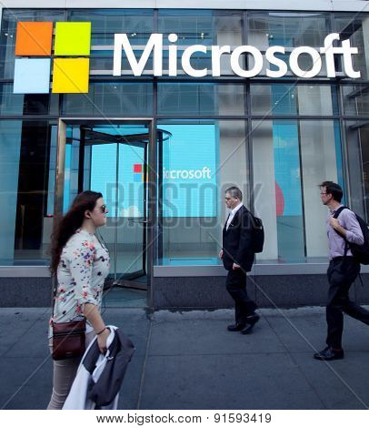 NEW YORK CITY - FRIDAY, MAY 8, 2015: Pedestrians walk past the corporate offices of Microsoft in Manhattan. Microsoft is an American technology company.