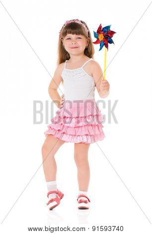 Little girl play with pinwheel toy windmill, isolated on white