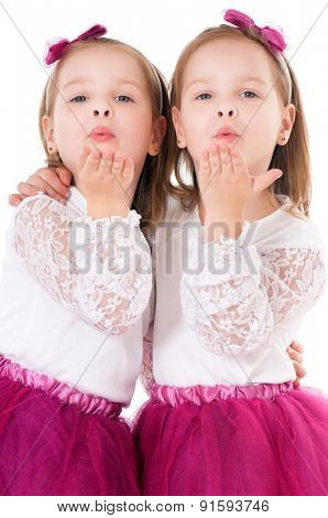 Cute little girls sends kiss goodbye, isolated on white
