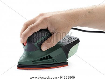 Carpenter's hand sanding with electrical sander isolated on white background.