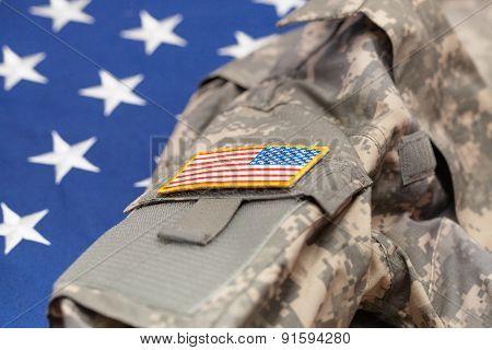 Usa Army Uniform Over National Flag - Studio Shot