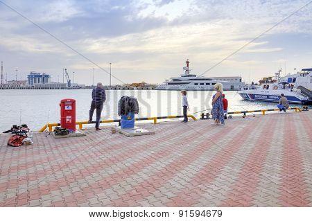 City Sochi. Marine Port. Fishermen