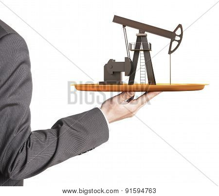 Oil pump on the plate in hand