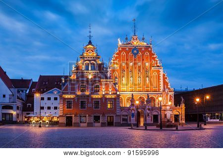 Riga Town Hall Square, House of the Blackheads illuminated in the evening twilight, Riga, Latvia