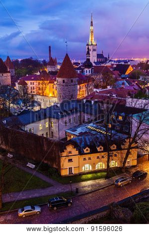 Aerial view of Tallinn Medieval Old Town illuminated in evening, Estonia