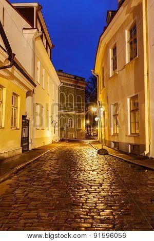 Tallinn Old Town street with cobblestones in night, Estonia