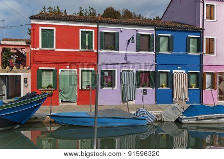 Colorful houses and canal on Burano island