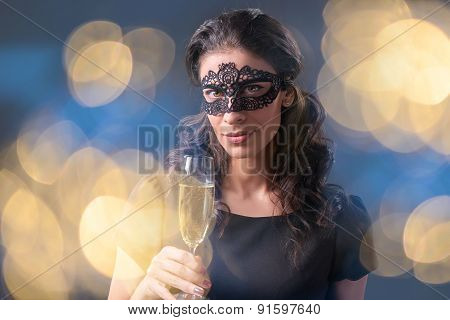 Party woman holding glass with champagne
